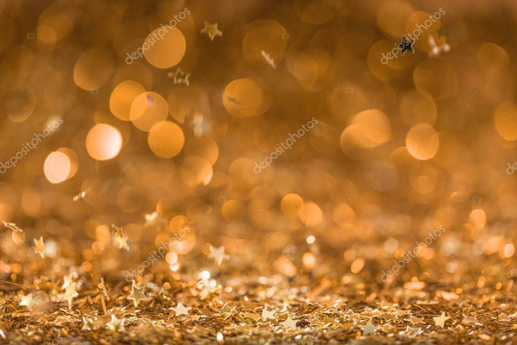 Christmas background with falling golden shiny confetti stars stock vector