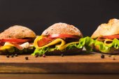 Fotografie close up of sandwiches with cheese and vegetables