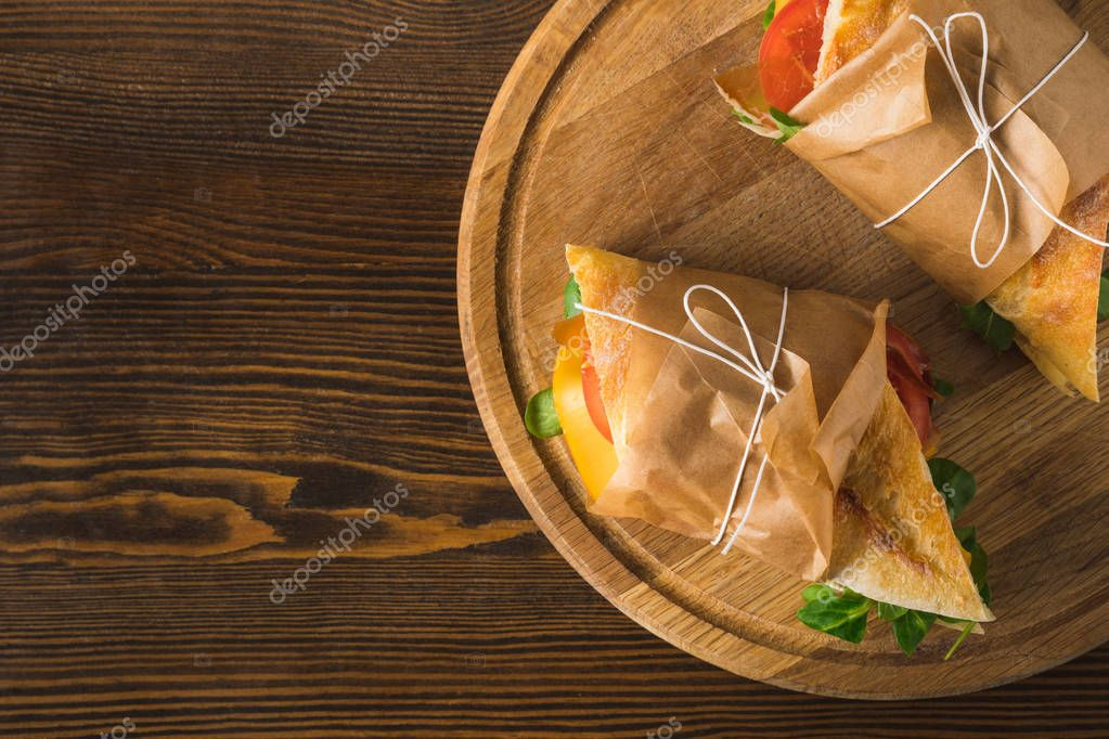 top view of two delicious panini on cutting board