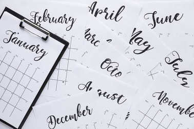 top view of arranged notepad and paper calendar