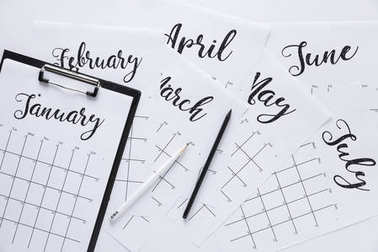 flat lay with calendar, notepad and pencils isolated on white