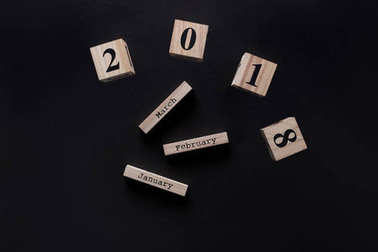 top view of parts of wooden calendar isolated on black