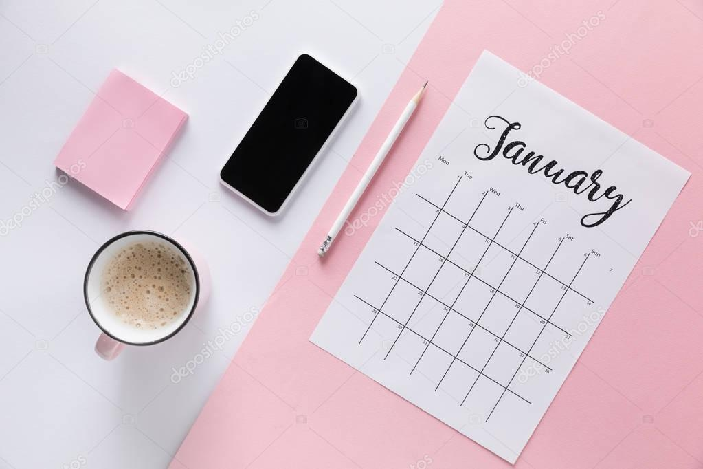 flat lay with calendar, smartphone, cup of coffee and blank sticky notes