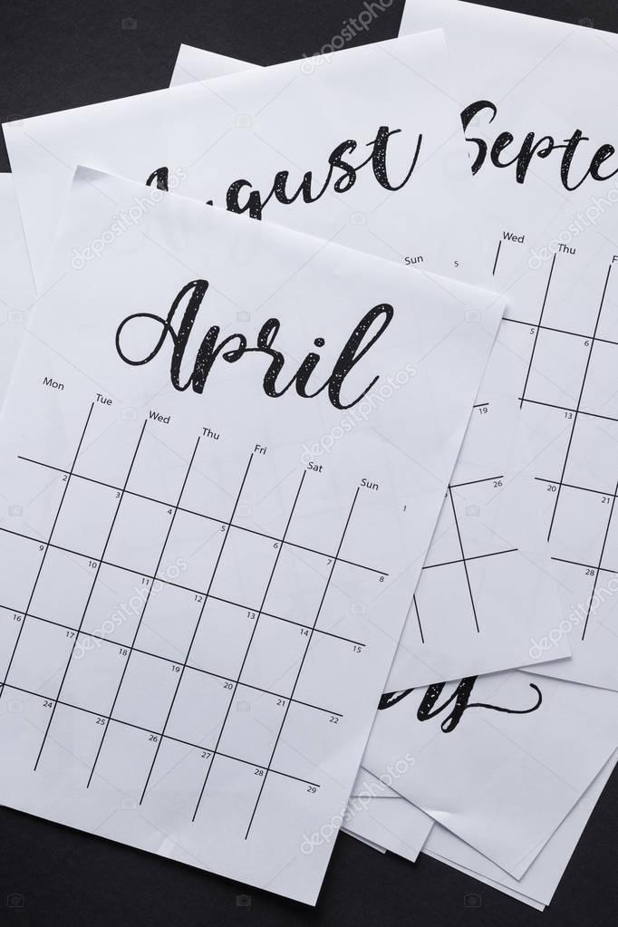 close up view of parts of paper calendar isolated on black