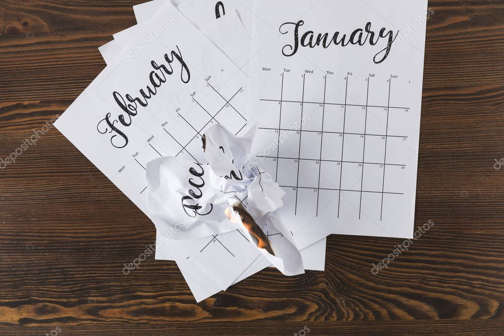 top view of teared paper calendar on wooden tabletop