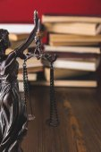 statue lady justice on wooden table with books, law concept