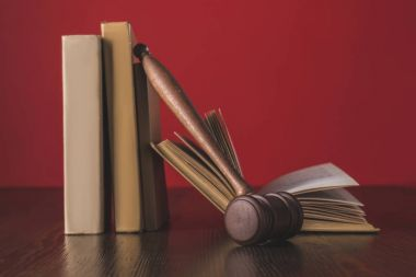 juridical books with hammer on wooden table, law concept