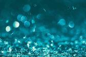 Fotografie Slavnostní pozadí s zářící konfety v tyrkysových odstínech