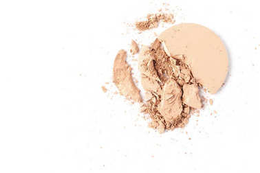 cracked circle of cosmetic powder isolated on white