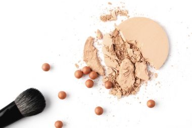 nude cosmetic powder with makeup brush isolated on white