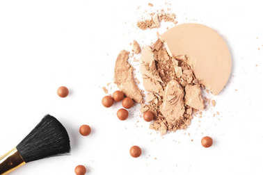 nude cosmetic powder with brush isolated on white