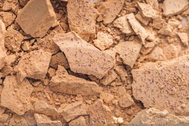 top view of crushed cosmetic powder as background
