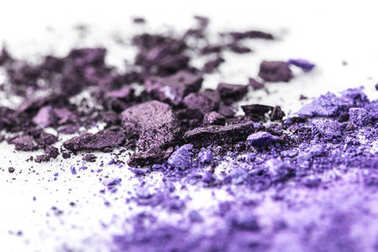 crushed purple cosmetic eye shadows on white surface