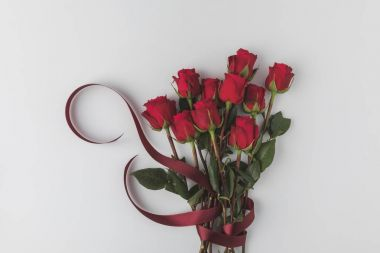 top view of beautiful red roses with ribbon isolated on white, st valentines day concept