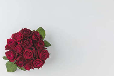 top view of bouquet of red roses isolated on white