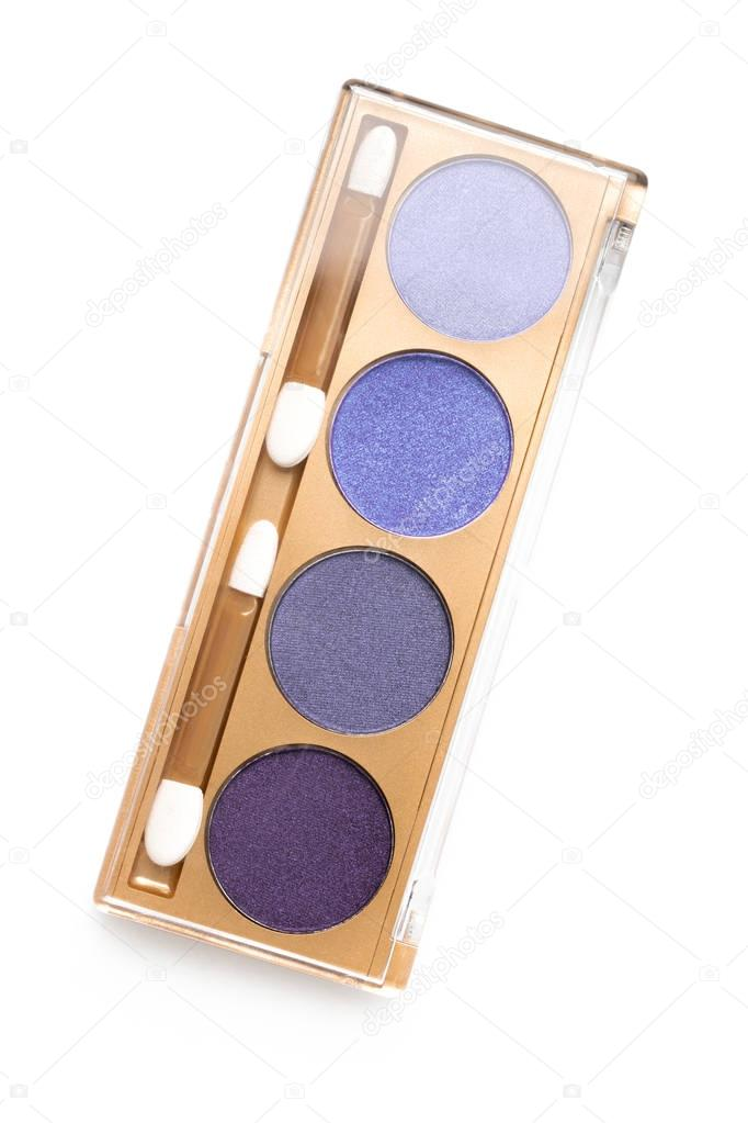 top view of case with different shaded purple cosmetic eye shadows isolated on white