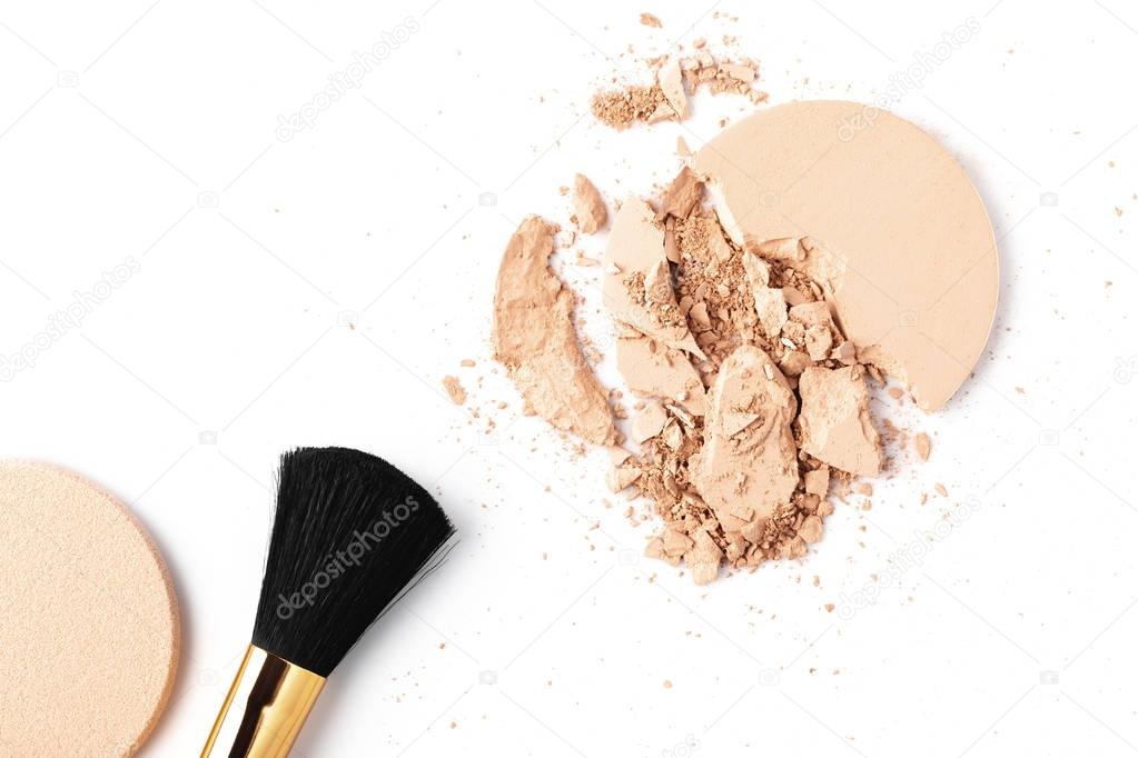 cracked cosmetic powder isolated on white