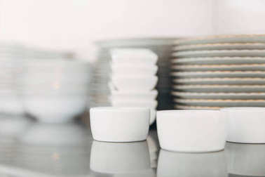 close-up shot of stacks of various clean tableware at restaurant