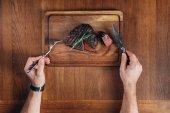 medium rare grilled steak on wooden board