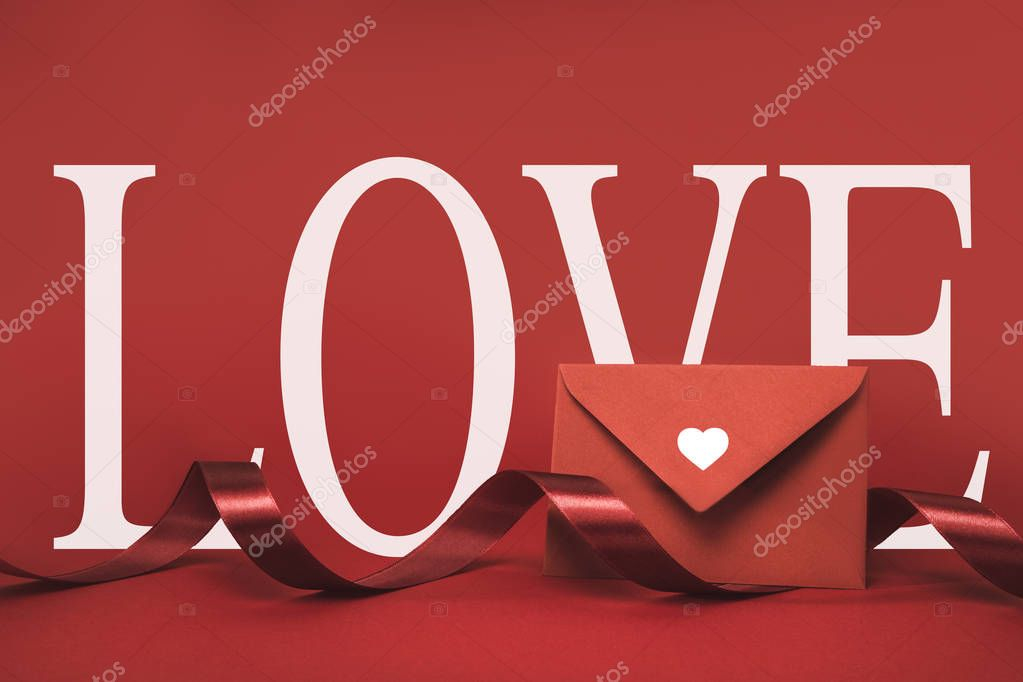 Close up view of envelope and ribbon isolated on red stock vector