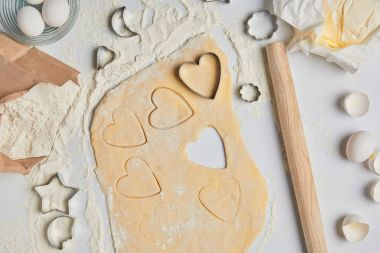 top view of preparation of heart shaped cookies, valentines day concept