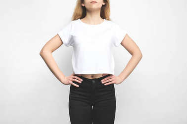 Stylish young woman in blank t-shirt on white stock vector