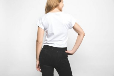 back view of young woman in blank t-shirt on white