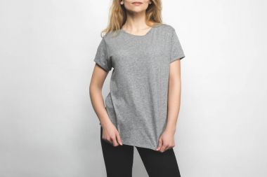 cropped shot of woman in blank grey t-shirt on white