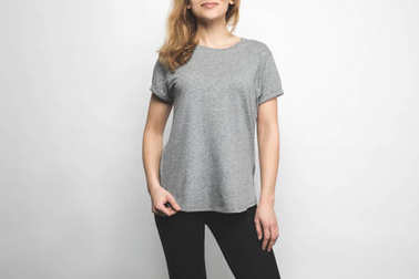 cropped shot of attractive young woman in blank grey t-shirt isolated on white