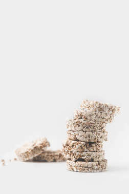 stack of crispy rice cakes on white tabletop