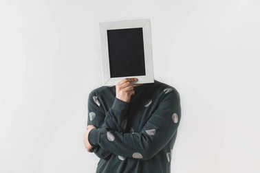 man covering face with black board isolated on white