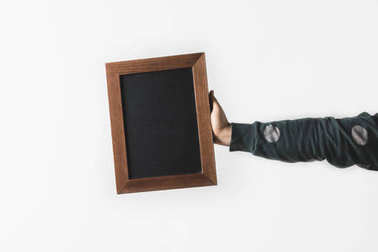 cropped image of man holding empty black board isolated on white