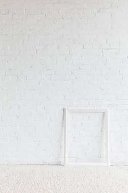 Empty frame in front of white brick wall, mockup concept stock vector