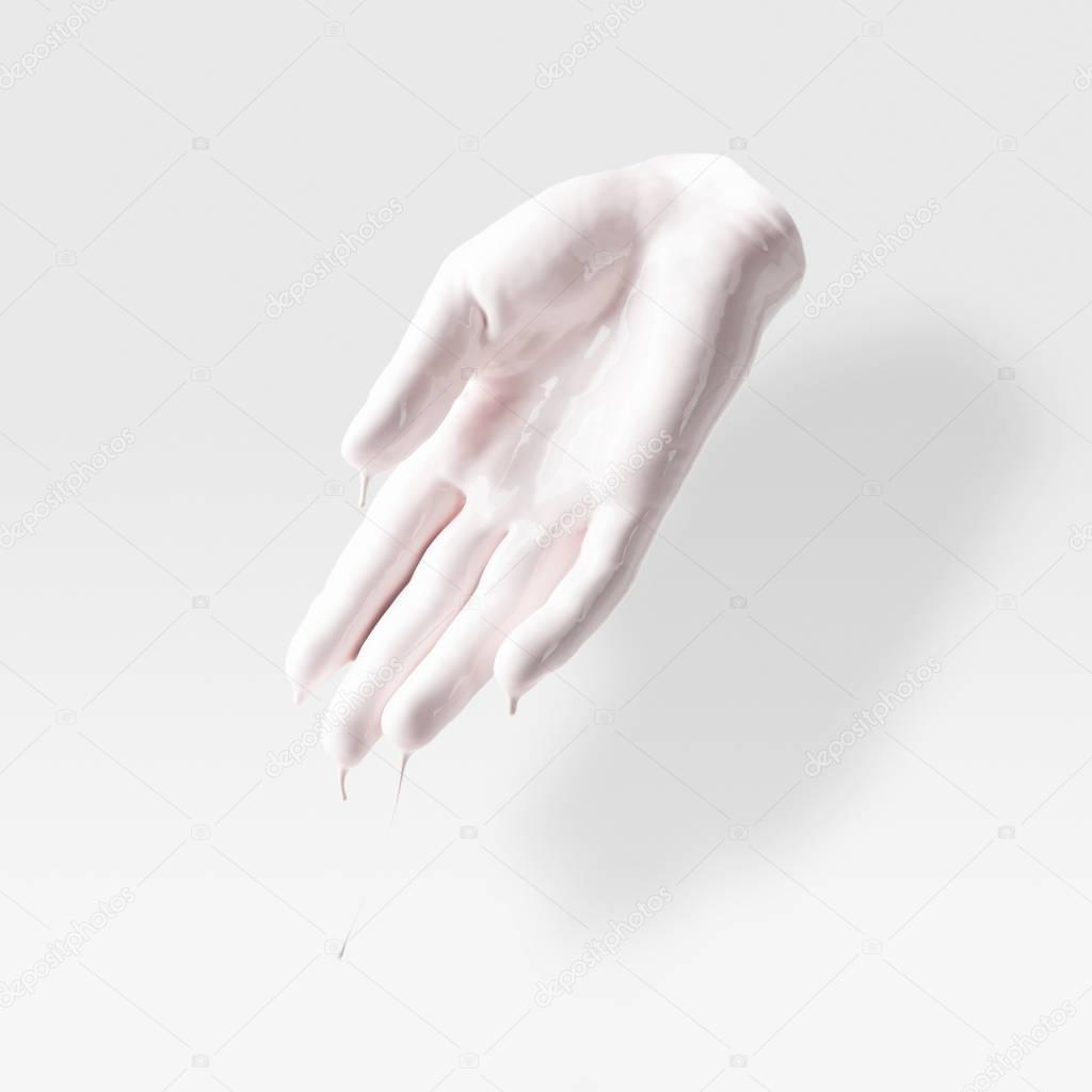 abstract sculpture in shape of human arm in white paint on white
