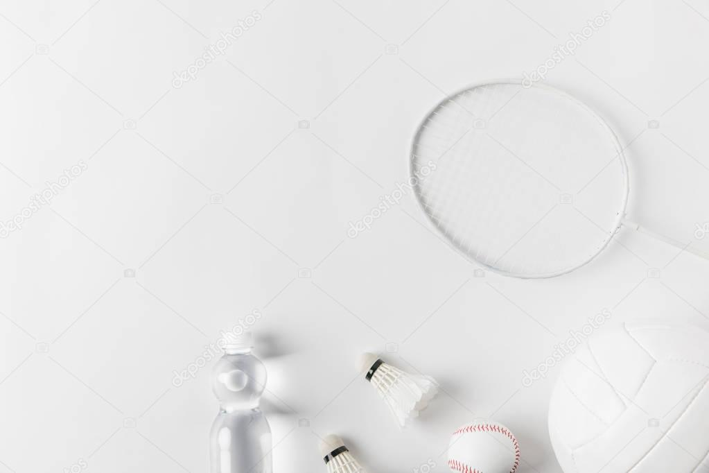 variation of sports equipment on white surface