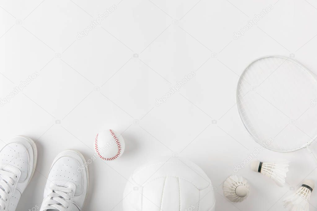 various sports equipment on white surface