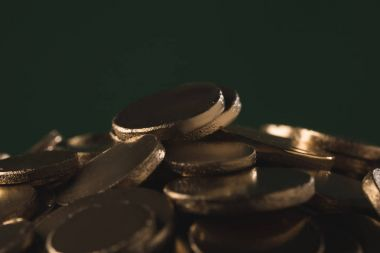 close up of golden coins on green, st patricks day concept
