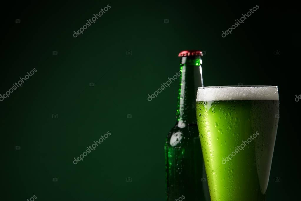glass bottle and glass of green beer, st patricks day concept