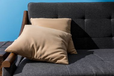 close-up shot of pillows lying on comfy couch