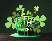 close up view of green hat on wooden surface and green is the theme, march 17 lettering