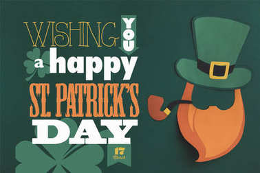 close up view of paper made green hat and beard with wishing you a happy st patricks day lettering on green background