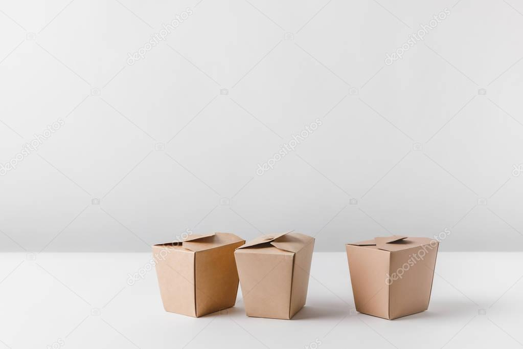 three noodles boxes on white surface