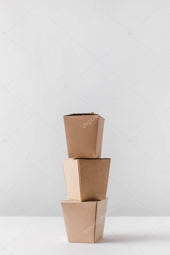 three food containers on white table