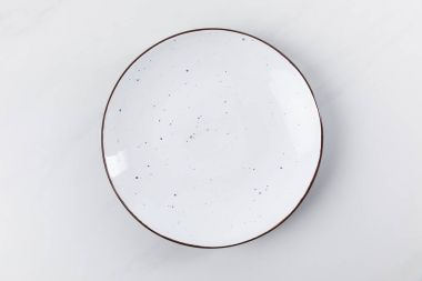 Top view image of plate placed on white surface, minimalistic conception