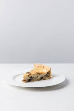 Closeup view of delicious pie on plate placed on white surface
