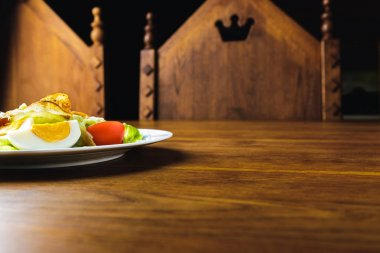close-up view of tasty caesar salad on wooden table