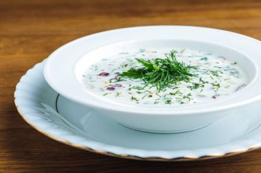 close-up view of delicious cold summer soup with yogurt and vegetables