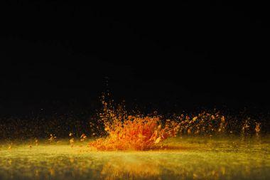 yellow holi powder explosion on black, Hindu spring festival