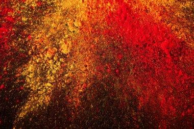 colorful holi powder explosion on black