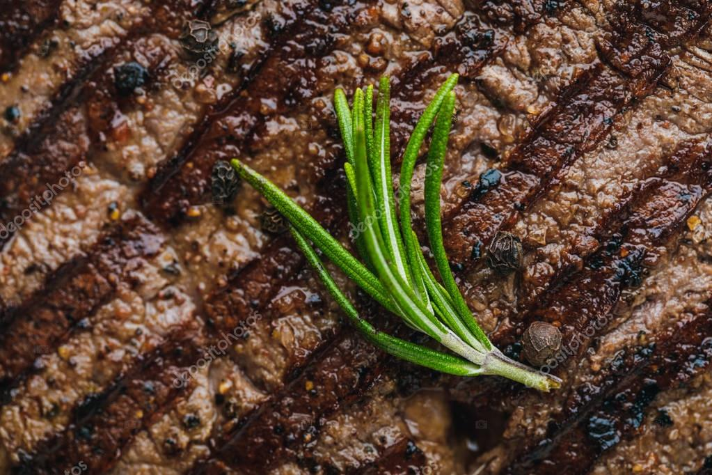 close-up view of delicious grilled spicy beefsteak with rosemary